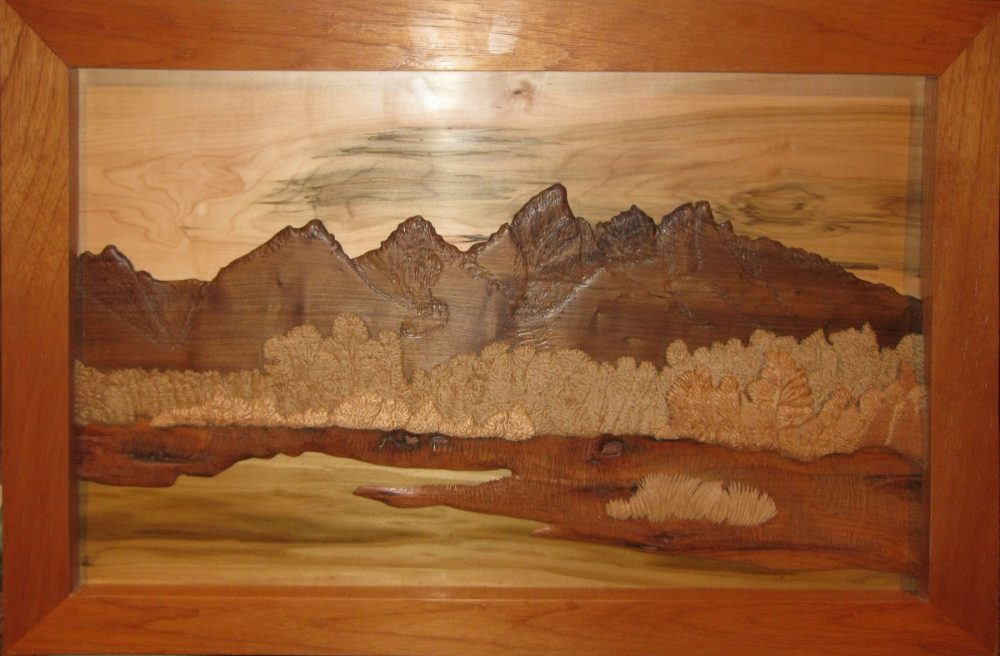 Grand Teton mountain range in layered hardwood relief sculpted by Francis