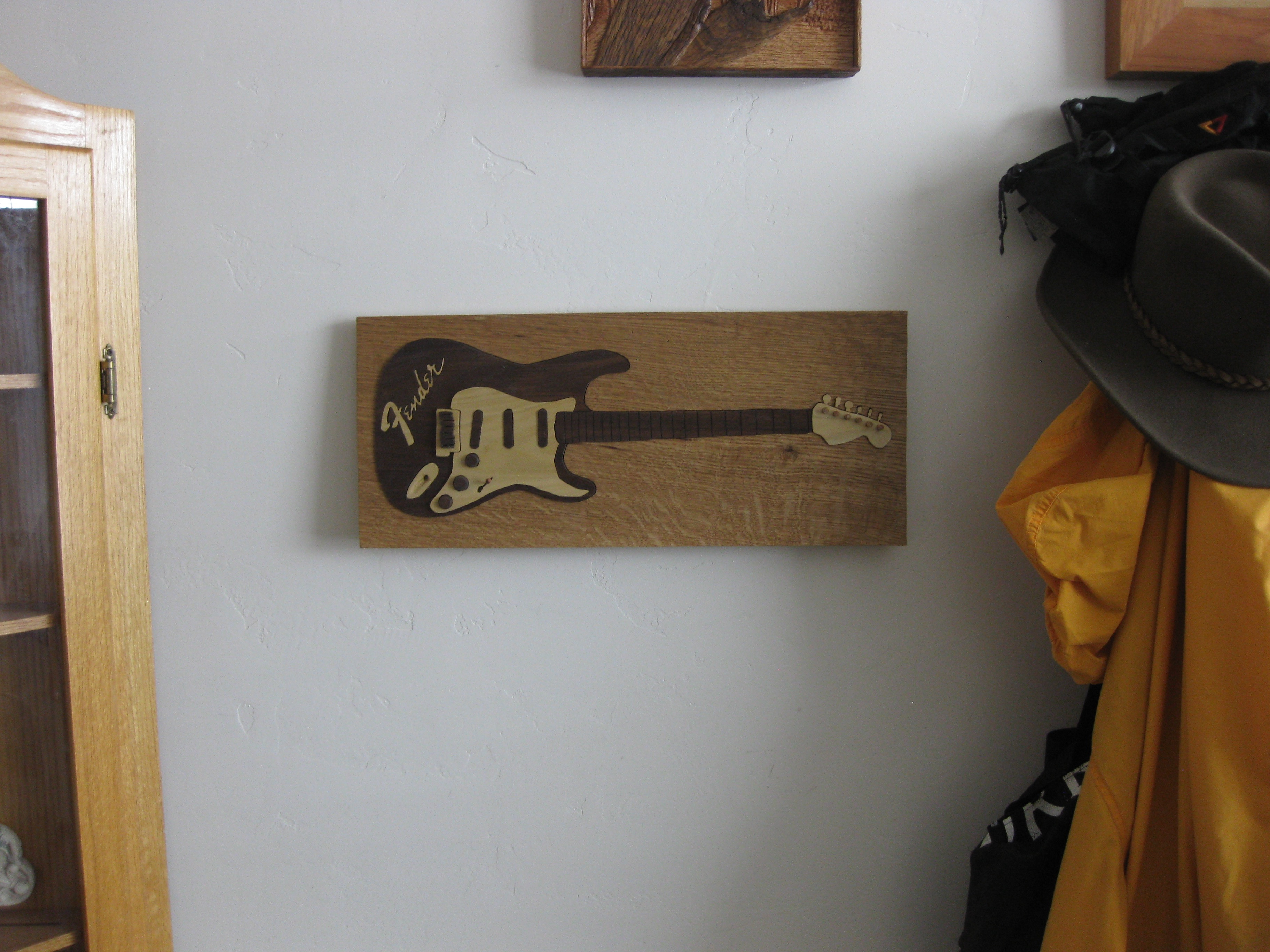 Vintage Fender Puzzle hanging on wall