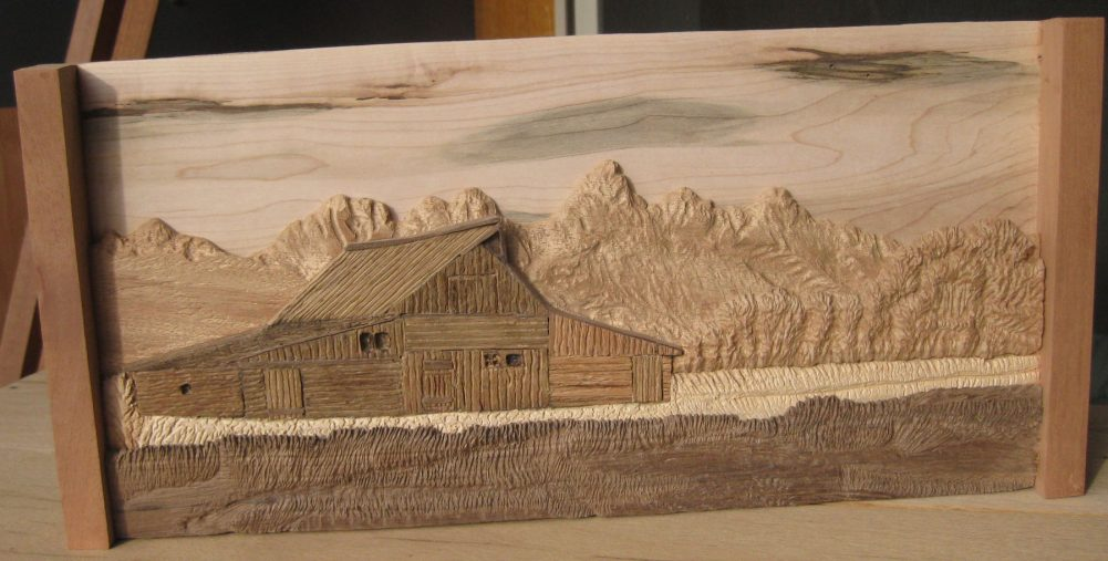 Moulton Barn in layered hardwood relief sculpted by Francis Koerber