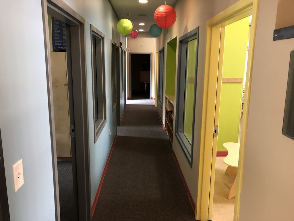 Main Hallway with Blue Corkboard Wall